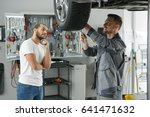 male car owner watching... | Shutterstock . vector #641471632