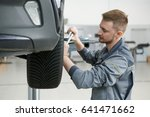 professional mechanic torquing...   Shutterstock . vector #641471662