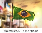 Stock photo brazil flag against city blurred background at sunrise backlight d rendering 641478652