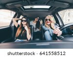 driving together. three... | Shutterstock . vector #641558512