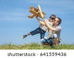 father and son playing with... | Shutterstock . vector #641559436