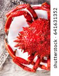 Small photo of Red Crab / Steamed crab on wooden background. Delicious seafood Red Crab / Steamed crab on wooden background. Delicious seafood