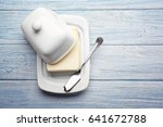 dish with butter and shovel on... | Shutterstock . vector #641672788