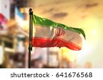 iran flag against city blurred... | Shutterstock . vector #641676568