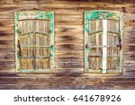 Two Windows Of Old Wooden Hous...