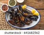 Mussels In White In A Plate On...