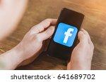 man using smartphone with... | Shutterstock . vector #641689702