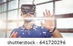 Small photo of Digital composite of Digital composite image of businessman wearing VR glasses