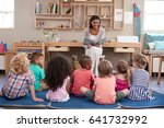 teacher at montessori school... | Shutterstock . vector #641732992