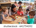 teacher and pupils using wooden ... | Shutterstock . vector #641754352