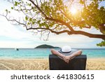 Woman relaxing on luxury beach with cocktail.  Smiling Young attractive hot.  Summer Concept - stock photo