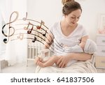 mother with baby at home.... | Shutterstock . vector #641837506