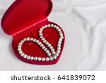 white pearl and jewelery case...