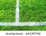 Soccer field with green grass and white lines - stock photo