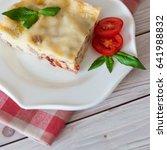 portion of tasty lasagna on... | Shutterstock . vector #641988832
