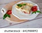 portion of tasty lasagna on... | Shutterstock . vector #641988892