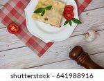 portion of tasty lasagna on... | Shutterstock . vector #641988916