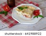 portion of tasty lasagna on... | Shutterstock . vector #641988922
