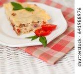 portion of tasty lasagna on... | Shutterstock . vector #641988976