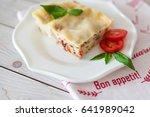 portion of tasty lasagna on... | Shutterstock . vector #641989042