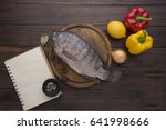 Tilapia Fish And Notepad And...