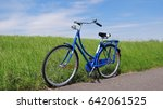 a blue bicycle on a dutch  ... | Shutterstock . vector #642061525