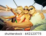 happy family steering the boat. | Shutterstock . vector #642123775