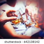 two hands clink glasses of... | Shutterstock . vector #642138142