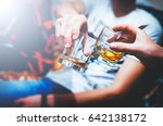 two hands clink glasses of... | Shutterstock . vector #642138172