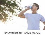 portrait of sport man drinking... | Shutterstock . vector #642170722