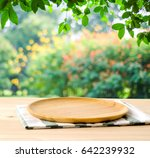 empty wooden tray on table over ... | Shutterstock . vector #642239932