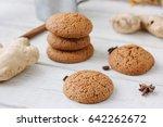 ginger snaps on white wooden...   Shutterstock . vector #642262672