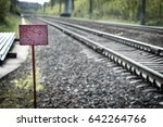 Red Nameplate Against Rails Fo...