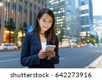 businesswoman use of mobile... | Shutterstock . vector #642273916