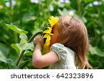 happy little girl smelling a... | Shutterstock . vector #642323896