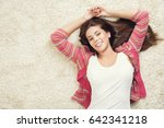 woman lying down on carpet ... | Shutterstock . vector #642341218