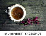 cup with tea on wooden table | Shutterstock . vector #642360406