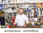 smiling young man cashier... | Shutterstock . vector #642408562