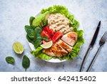 balanced nutrition. fresh salad ... | Shutterstock . vector #642415402