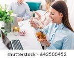 work team having lunch break  | Shutterstock . vector #642500452