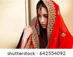 thoughtful indian bride covered ... | Shutterstock . vector #642554092