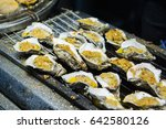 grilled oysters chinese style. | Shutterstock . vector #642580126