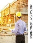 engineer builder with blueprint ... | Shutterstock . vector #642592402