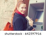 Young Happy Woman With Bank...