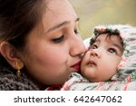 indian mother giving love to... | Shutterstock . vector #642647062