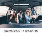 three girls driving in a... | Shutterstock . vector #642682015