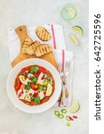 Small photo of Tomato, Capsicum, Chili and Coconut Milk Fish Stew, top view, copy space for your text