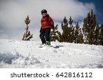 teenage boy snowboarding down... | Shutterstock . vector #642816112