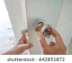 installation of the door lock.   Shutterstock . vector #642851872