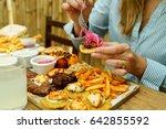 view of hands of people eating...   Shutterstock . vector #642855592